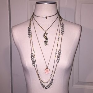 Pack of four long necklaces gold and silver tones